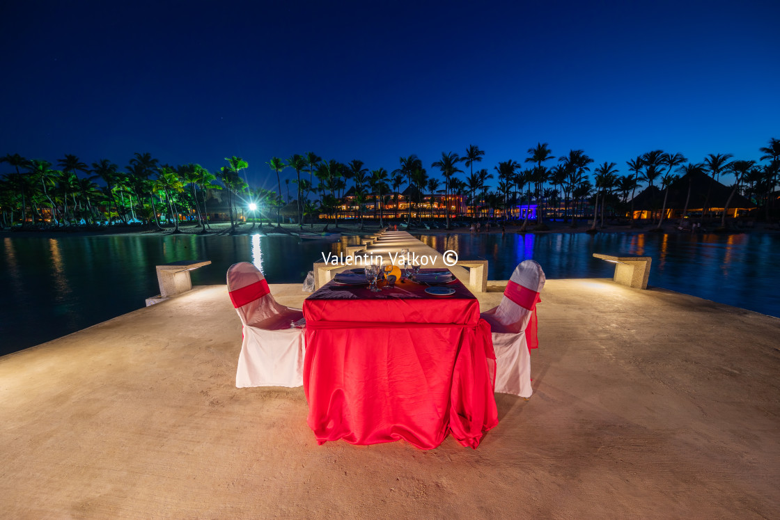 """Romantic dinner on the beach. Celebrating honeymoon on exotic is"" stock image"