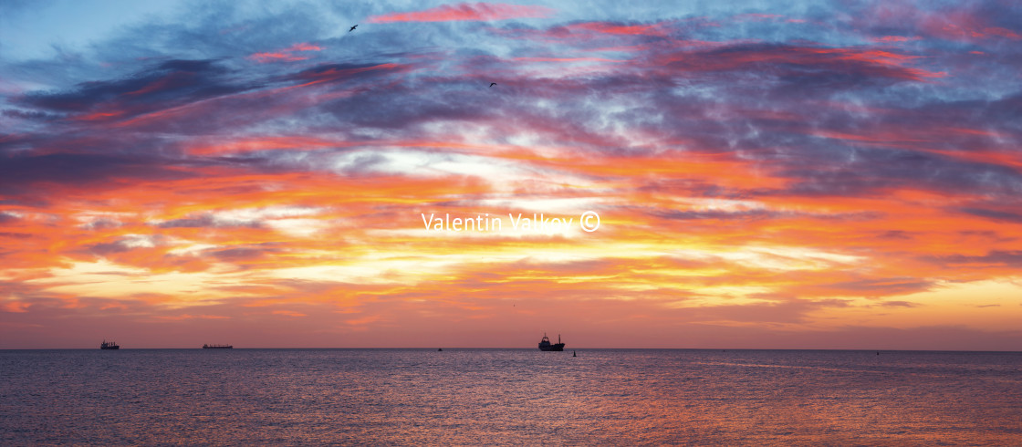 """Cargo ship with containers in sunrise light"" stock image"