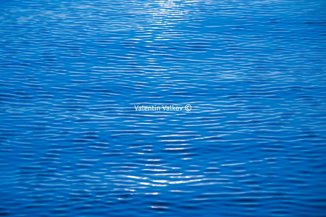 """Ocean ripples waves as water texture background"" stock image"