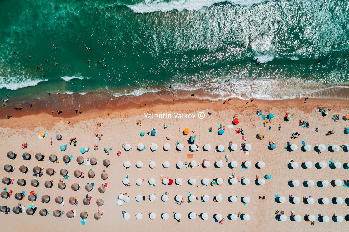 """""""Aerial top view on the beach. Umbrellas, sand and sea waves"""" stock image"""