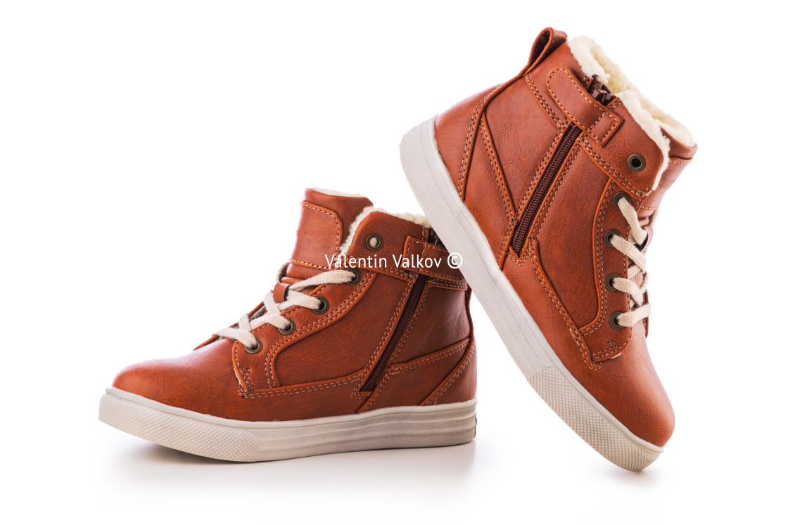 """""""Kids casual shoes. Winter boots or sneakers."""" stock image"""