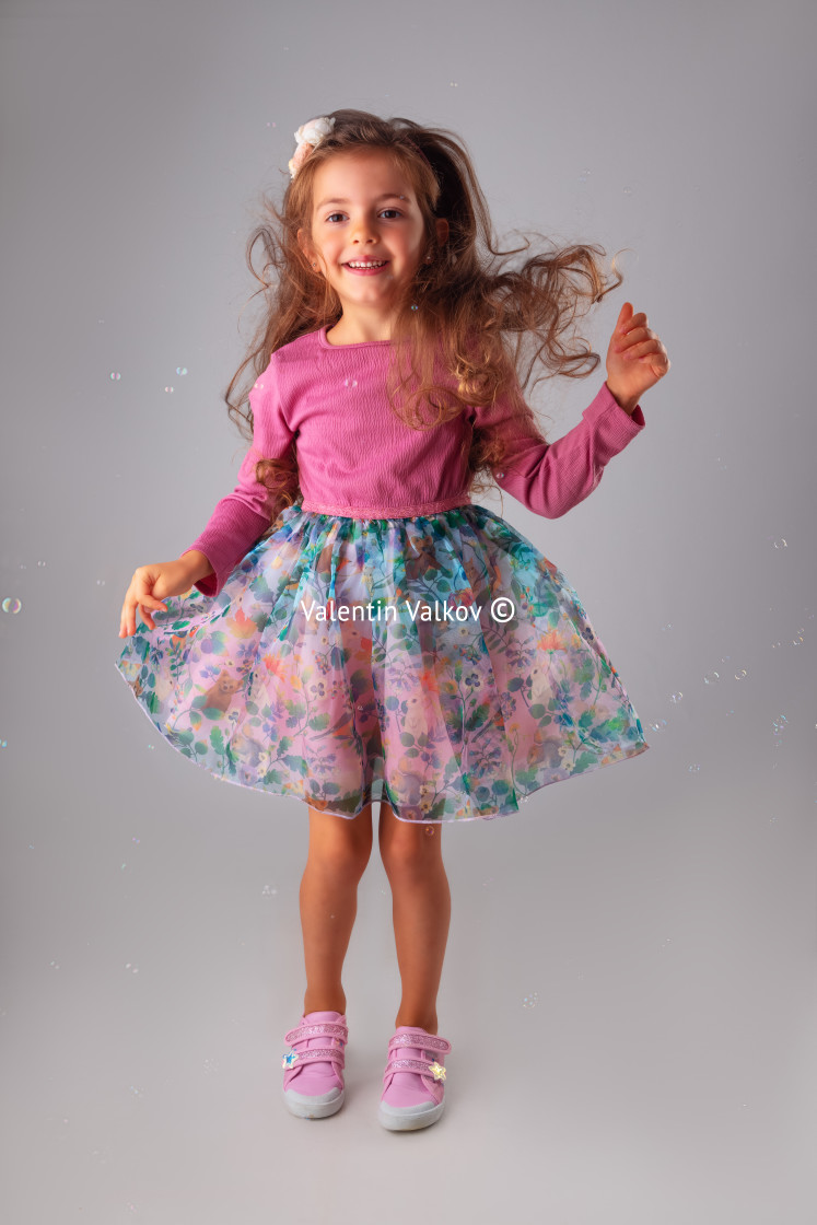 """Happy birthday girl in party dress portrait with copyspace for t"" stock image"