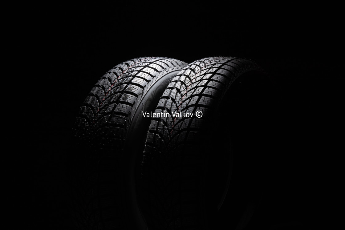 """Winter Car tire on black background"" stock image"