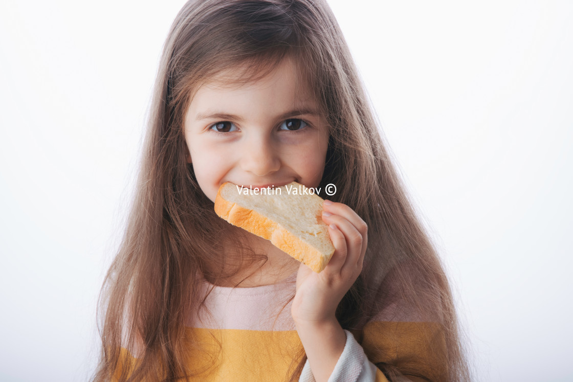 """Little girl hold slice of homemade healthy bread"" stock image"