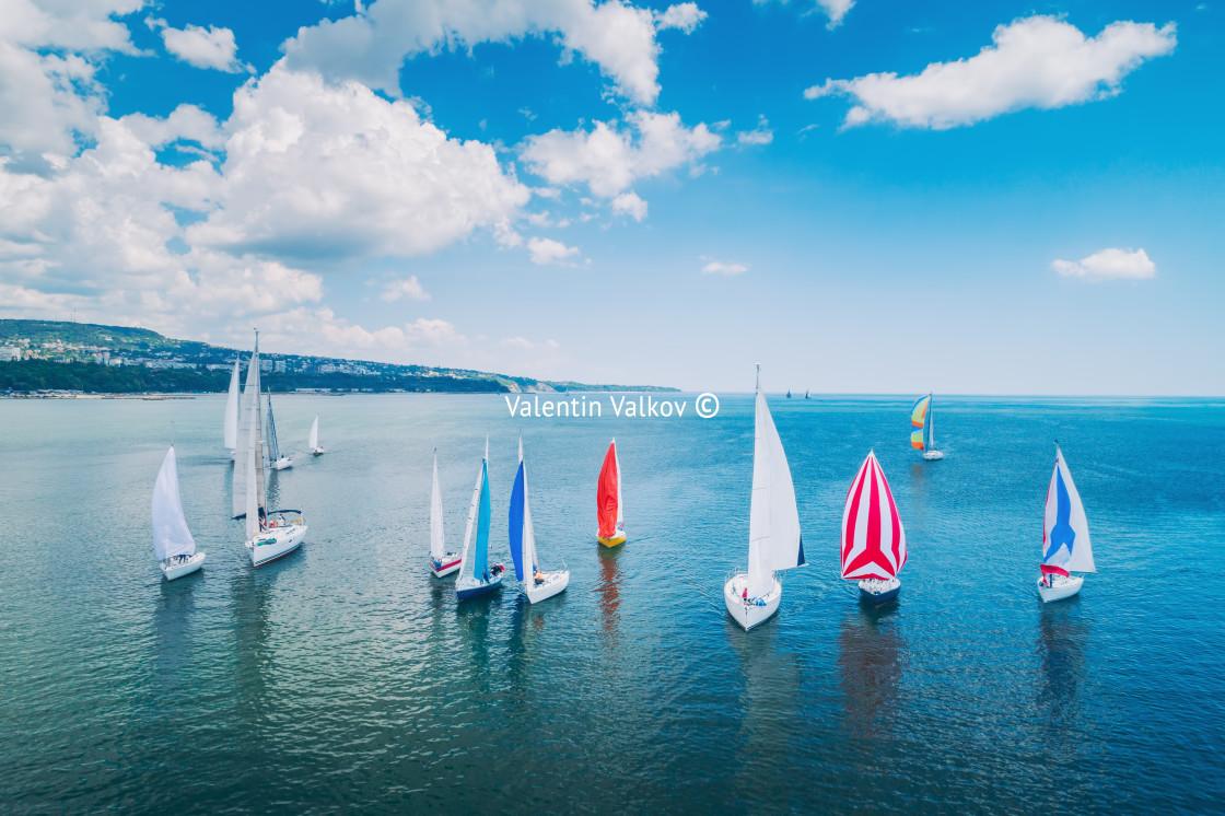 """Regatta sailing ship yachts with white sails at opened sea. Aeri"" stock image"