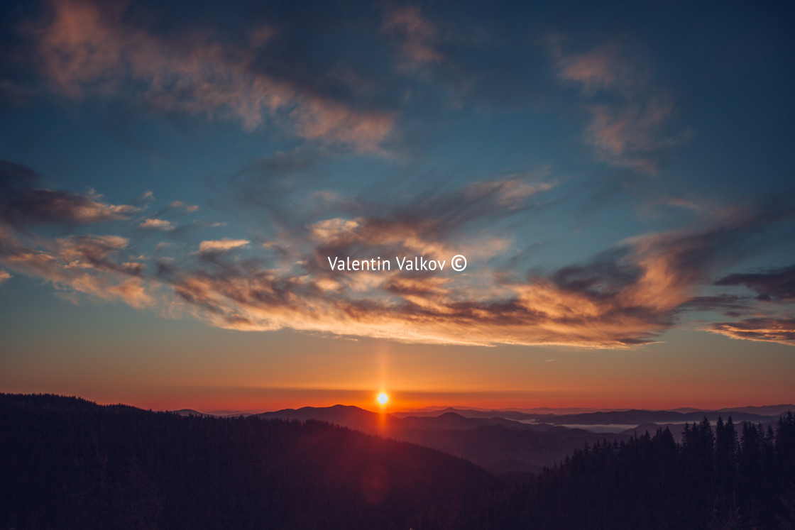 """""""Sunrise over the mountains"""" stock image"""