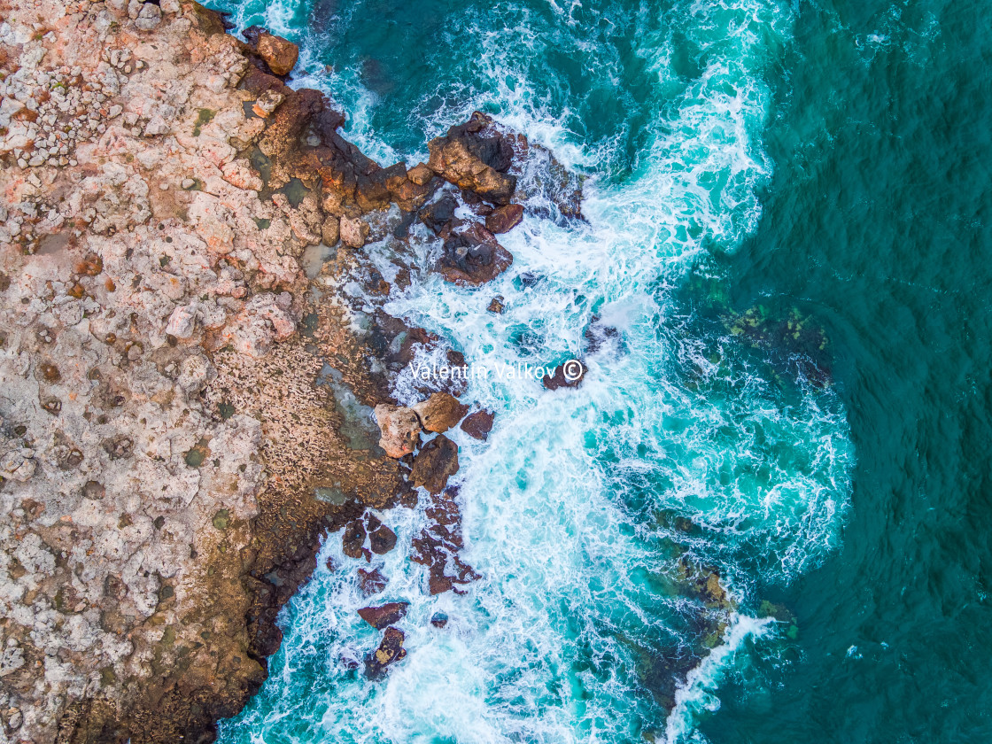 """""""Aerial view of rocky coastline and crashing waves"""" stock image"""
