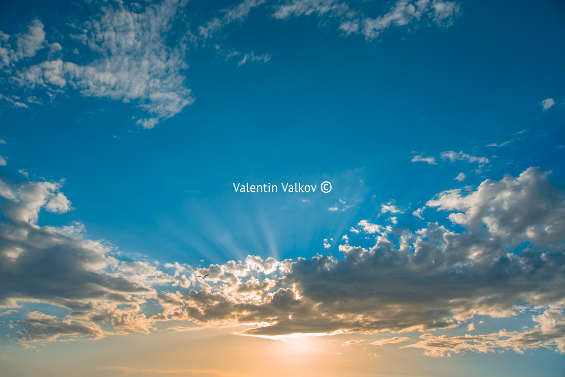 """""""Sunset dramatic sky clouds with sunbeam"""" stock image"""
