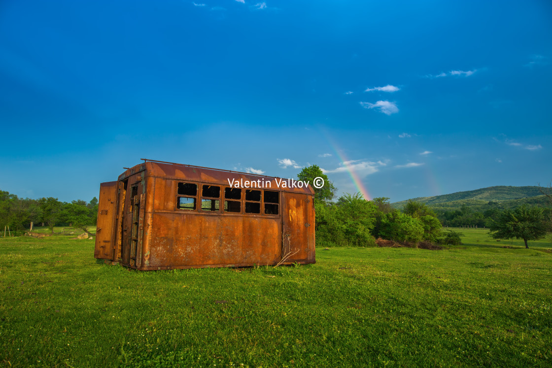 """""""Rainbow over fields and trees on a farm on the edge of Lake"""" stock image"""