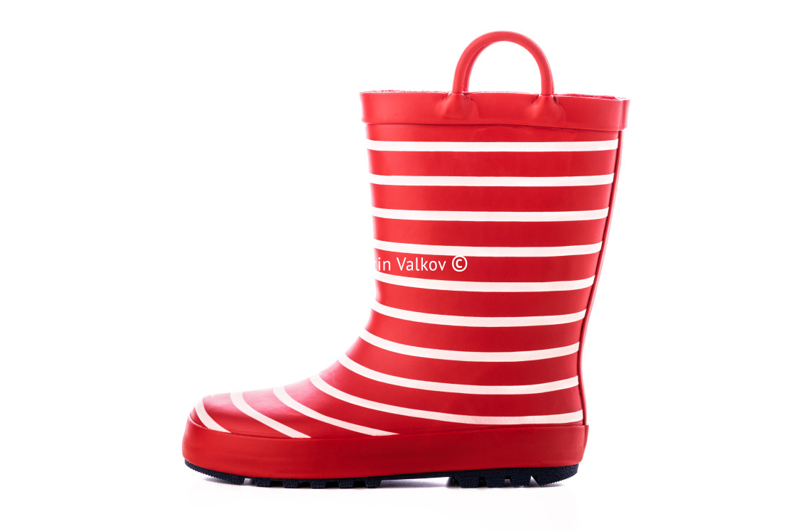 """""""Red striped kids rubber boots for rain isolated on white backgro"""" stock image"""