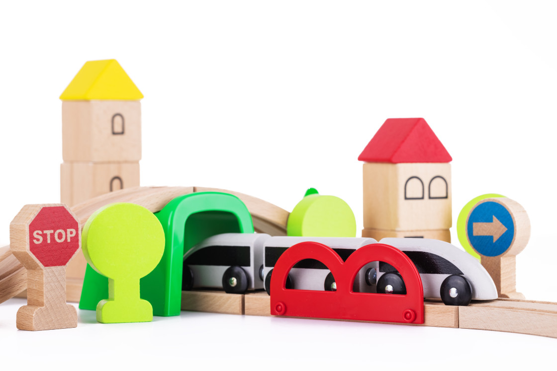 """""""Wooden train and railway road educational toys for kids on white"""" stock image"""