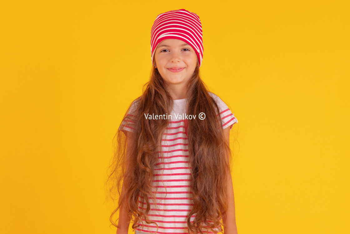 """""""Happy emotional girl smiling on colored yellow background. Autum"""" stock image"""