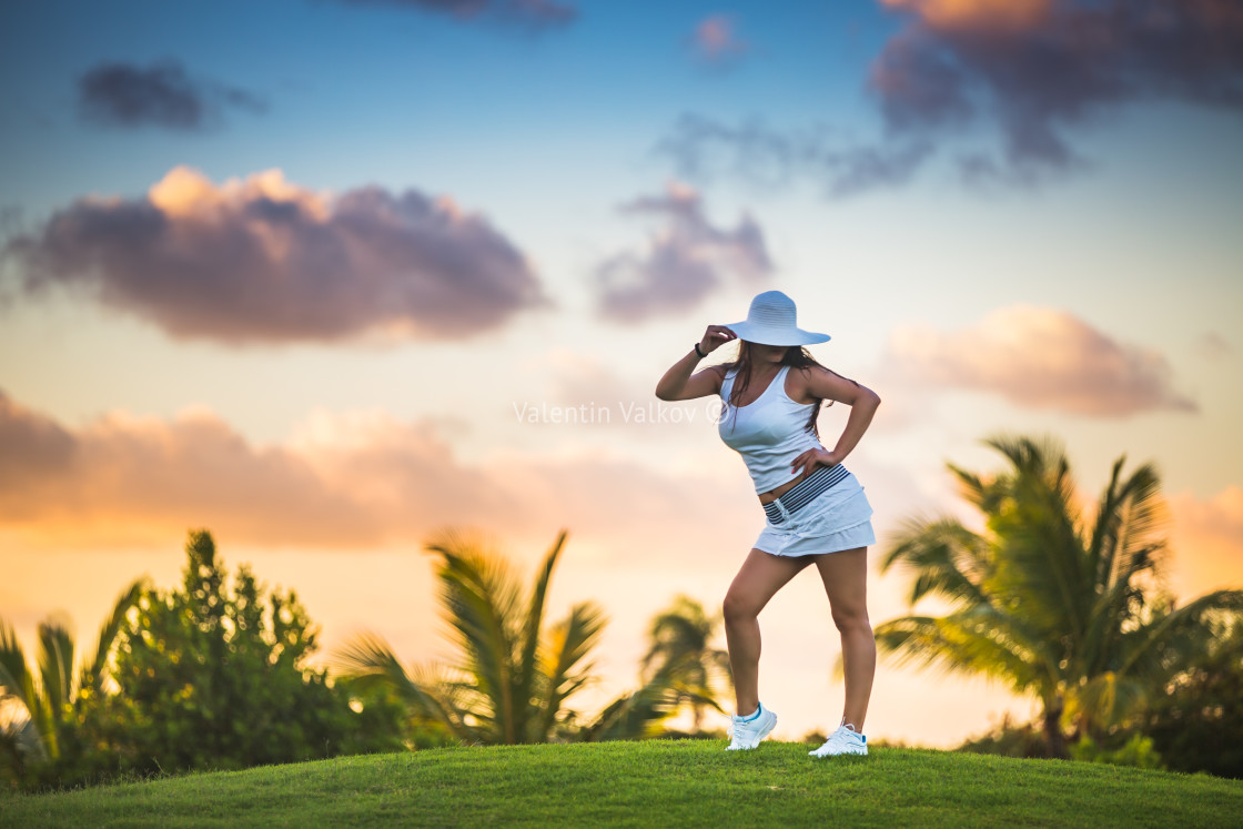 """Girl posing on the golf court in tropical resort Punta Cana, Dom"" stock image"