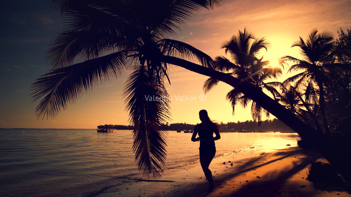 """Sea sunrise. Girl running on the tropical island beach Punta Can"" stock image"
