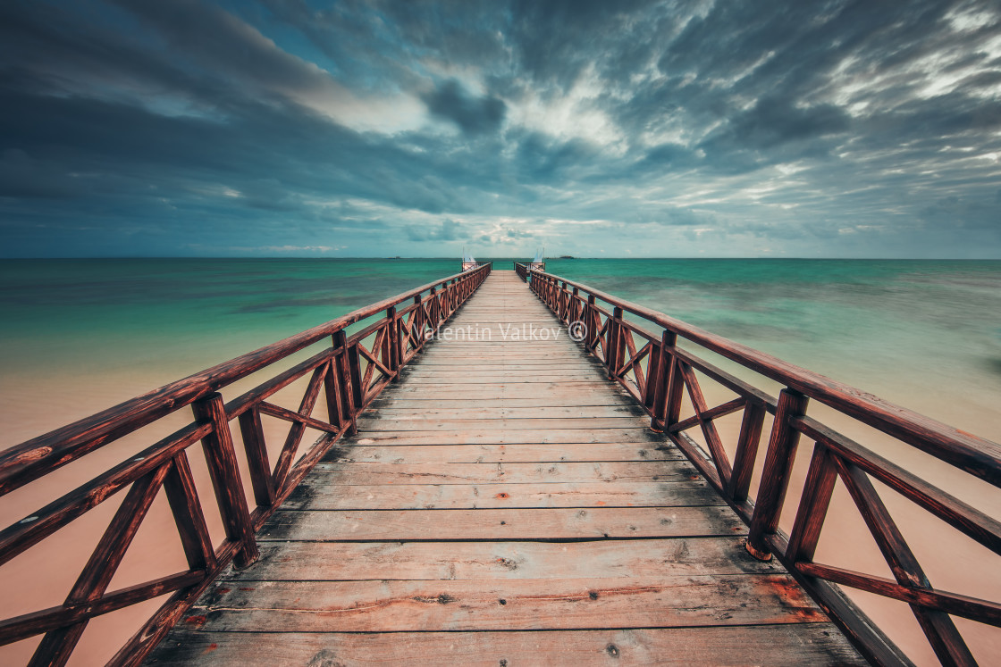 """Wooden jetty reaching into the turquoise Caribbean sea"" stock image"