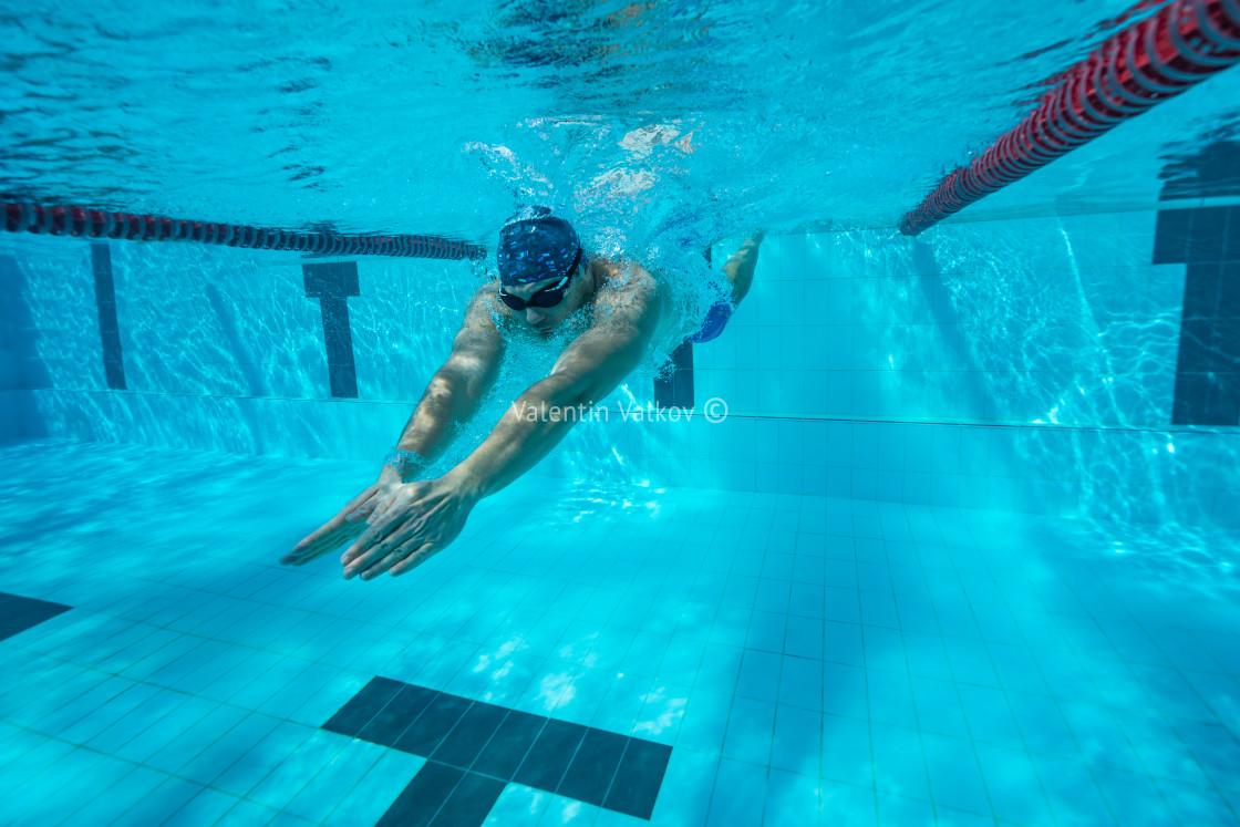 """Underwater man swimming in pool"" stock image"