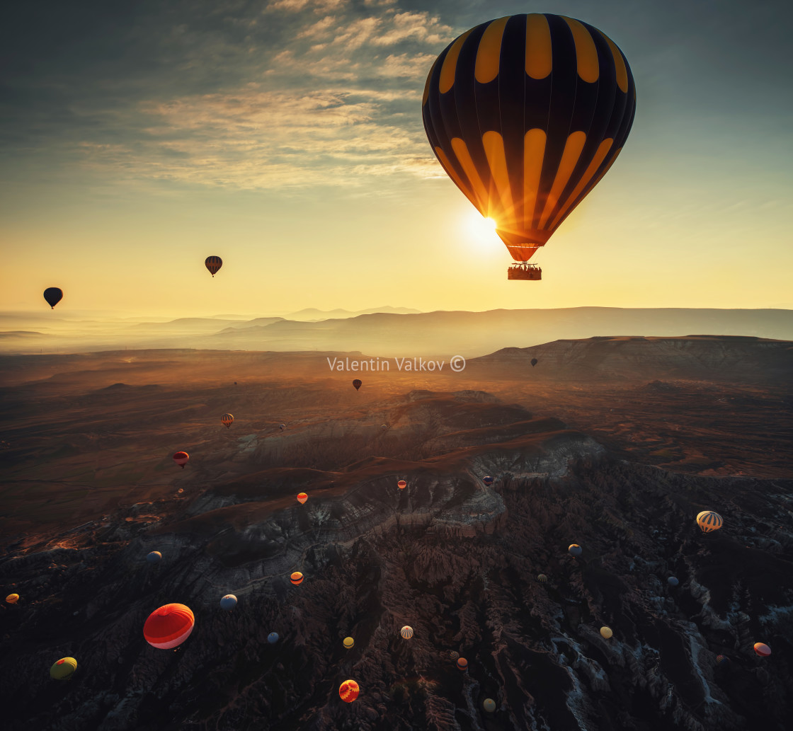 """Hot air balloons flying over the valley at Cappadocia."" stock image"