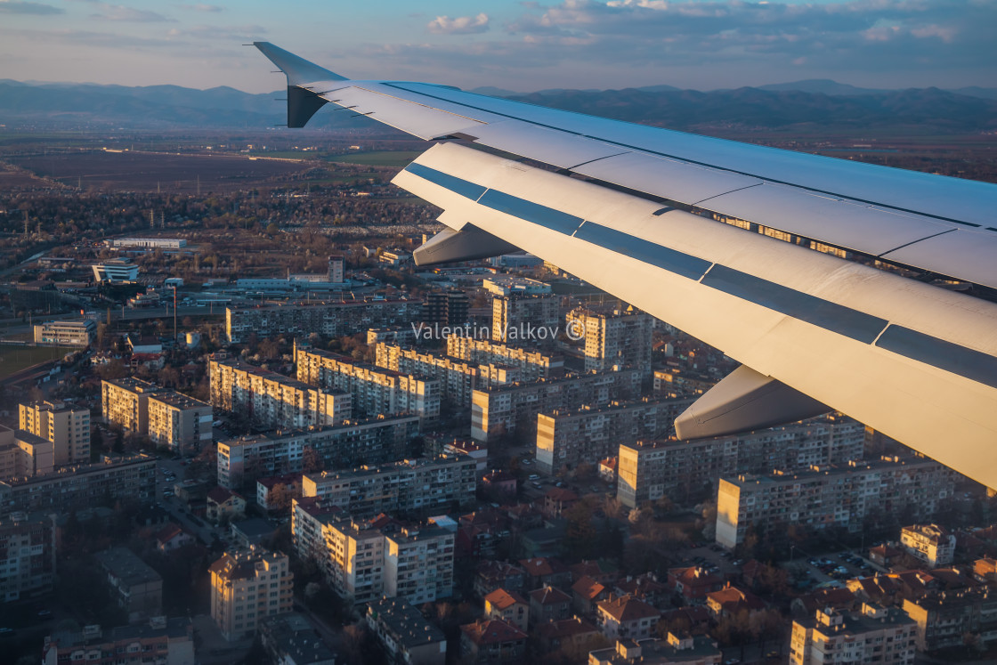 """Aerial view from the plane over buildings"" stock image"