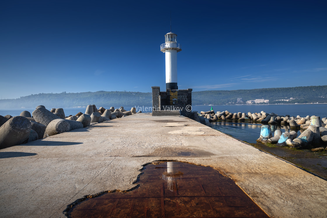 """Sea lighthouse at sunrise in Varna, Bulgaria"" stock image"
