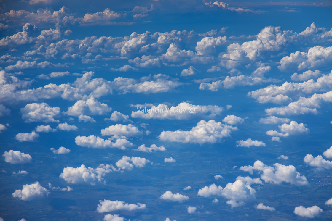 """Aerial view from the plane over tjhe clouds"" stock image"