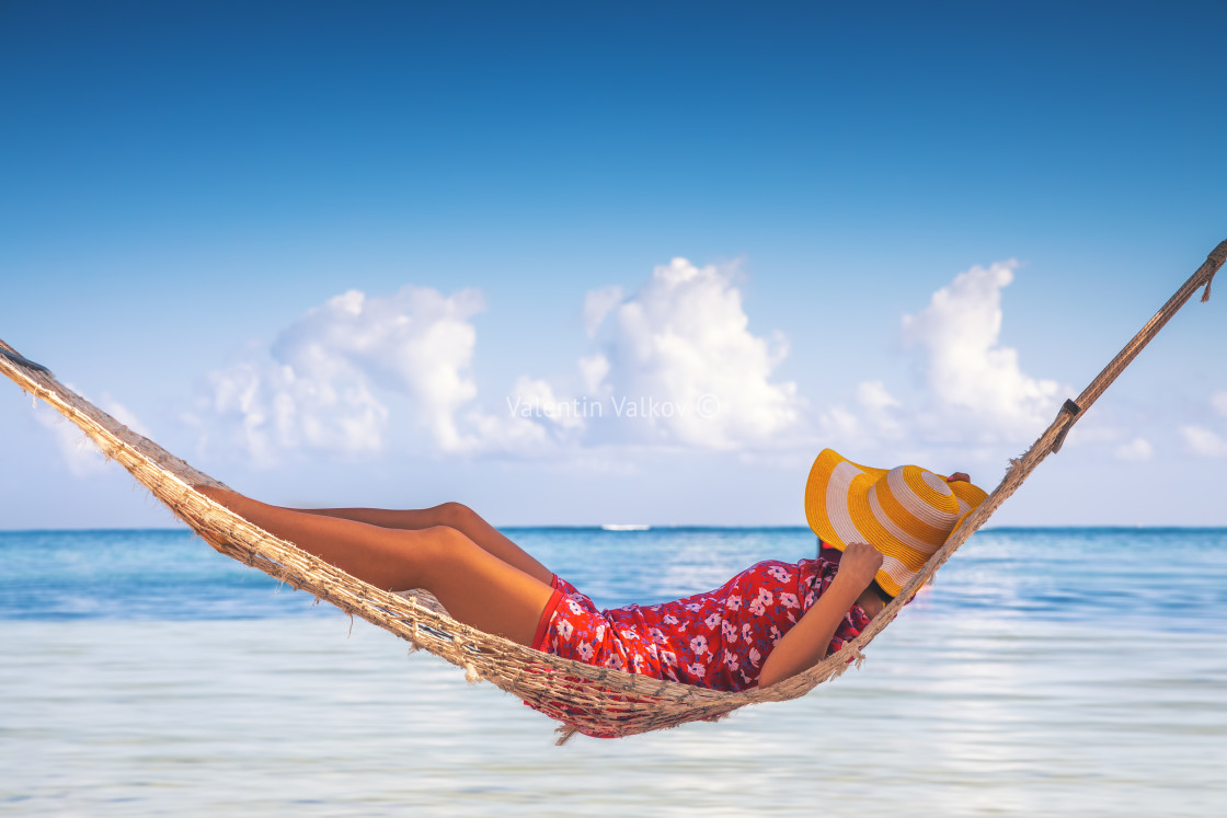 """Girl relaxing in a hammock on tropical island beach. Summer vaca"" stock image"