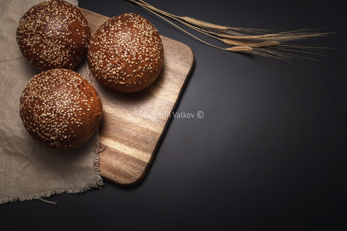 """Homemade sourdough bread. Burger bun isolated on wooden backgrou"" stock image"