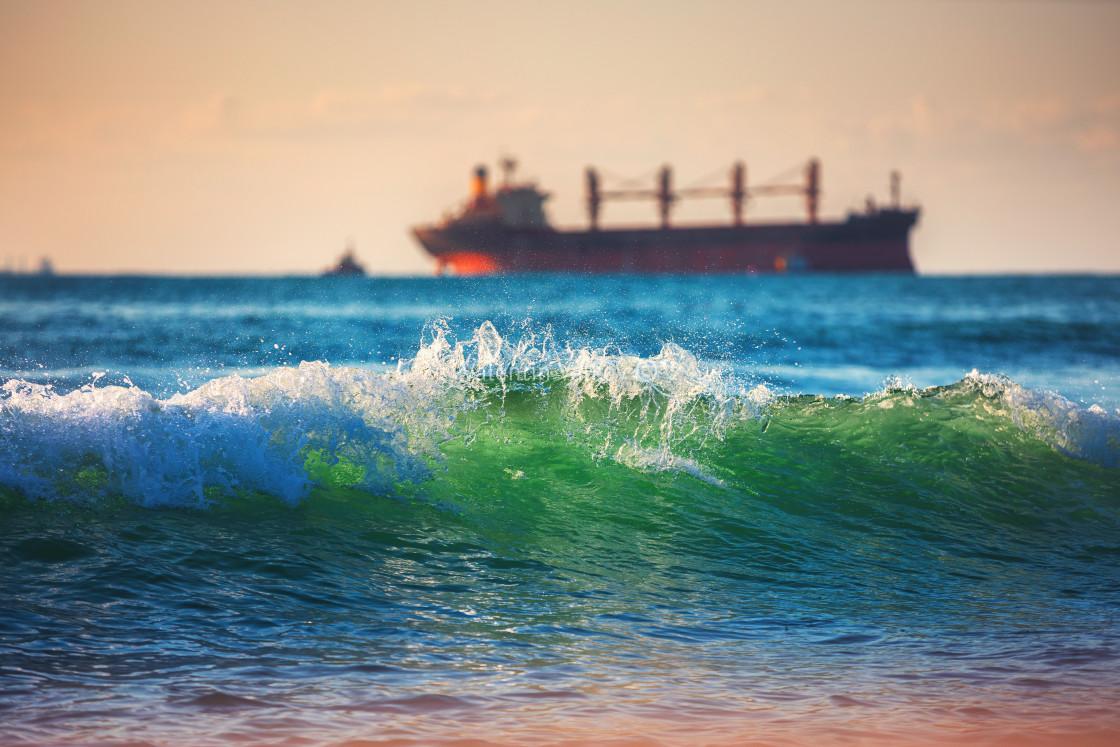 """""""Sailing cargo ship and waves at sunrise. Transportation. Logisti"""" stock image"""