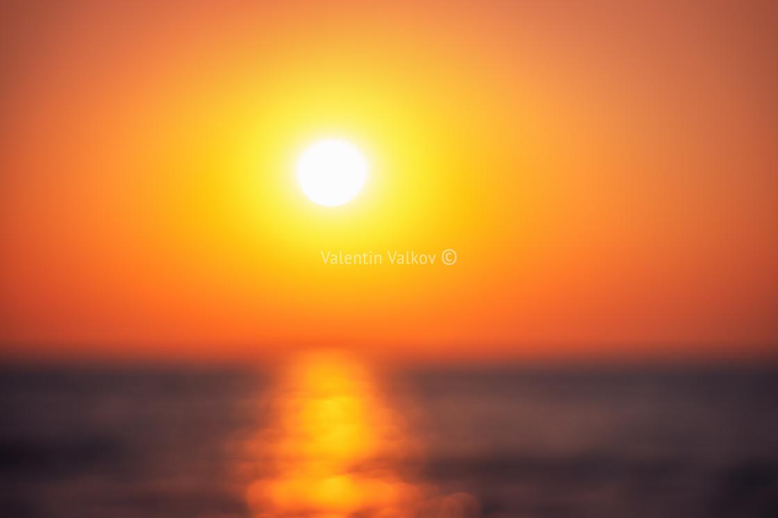 """Defocused background ot beautiful sunrise over the tropical sea"" stock image"
