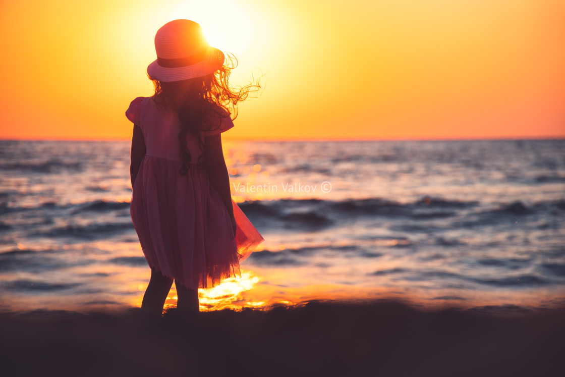"""Little girl playing on the beach"" stock image"