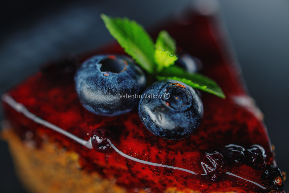 """""""Cake with berry fruits, chia cereals and nuts isolated on black"""" stock image"""
