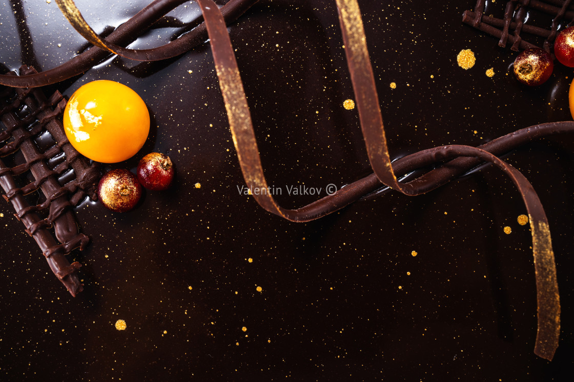 """Chocolate cake with decoration and fruits as background"" stock image"