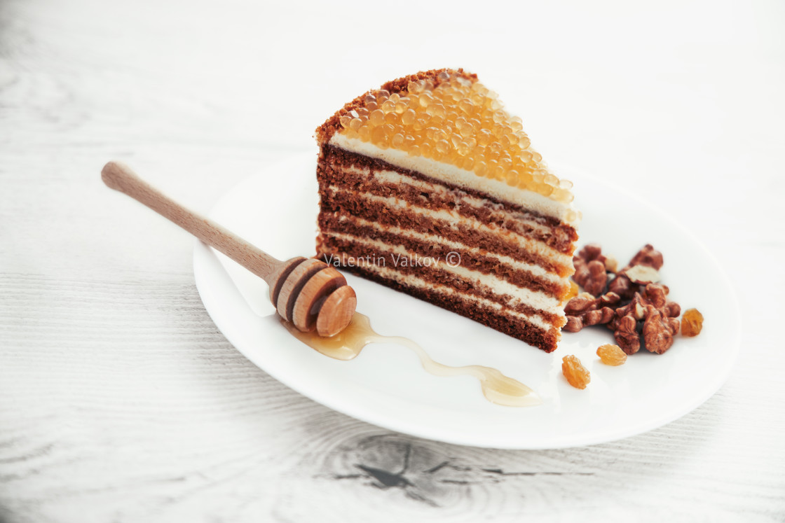 """""""Honey cake with golden pearls and mint leaf and cinnamon on ston"""" stock image"""