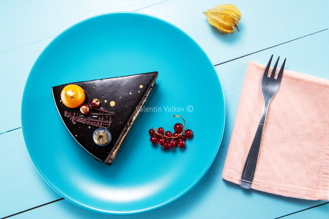 """Chocolate cake with decoration and fruits wooden blue background"" stock image"