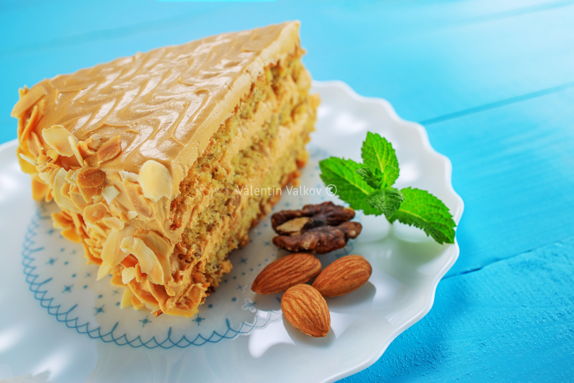 """Cake with peanuts, walnuts, chocolate and caramel cream on woode"" stock image"