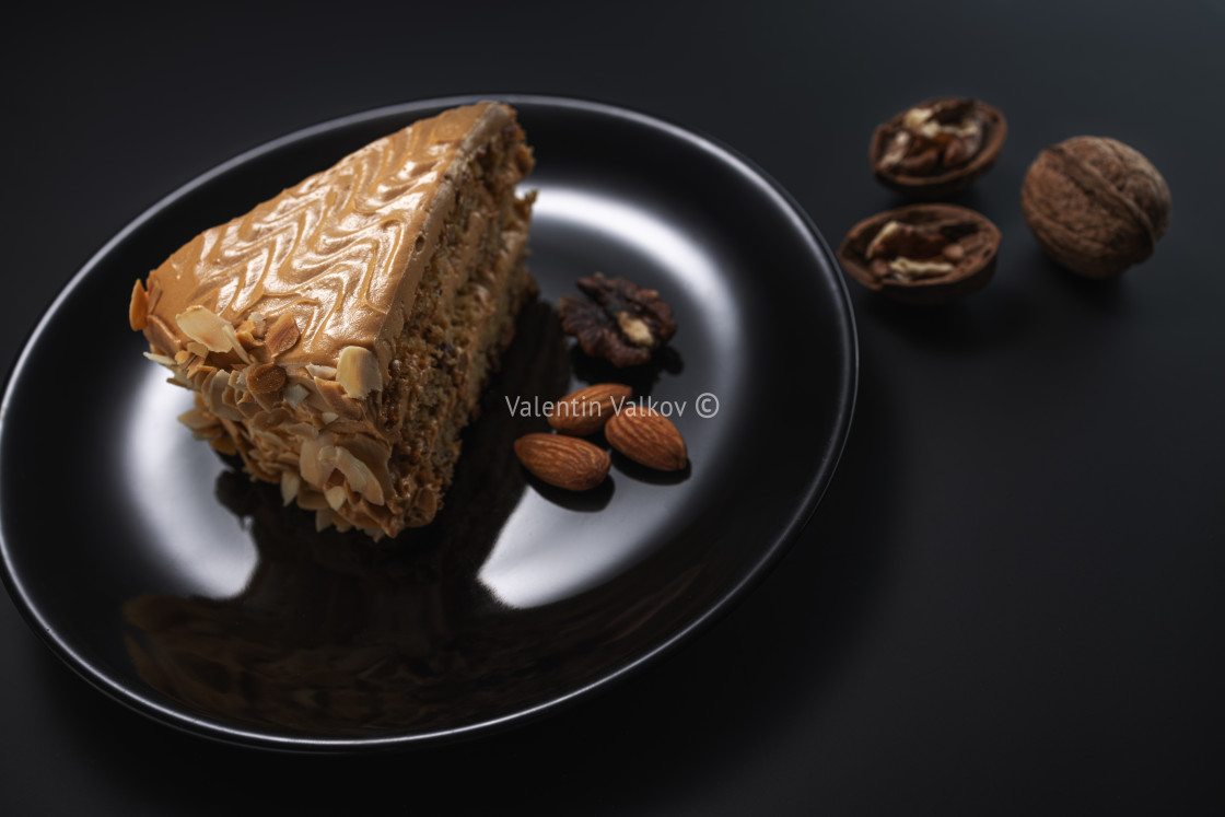 """Cake with peanuts, walnuts, chocolate and caramel cream"" stock image"