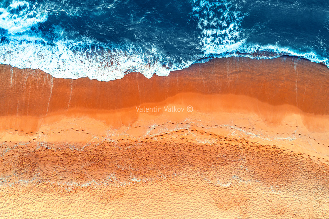 """Aerial view of waves in a beach"" stock image"