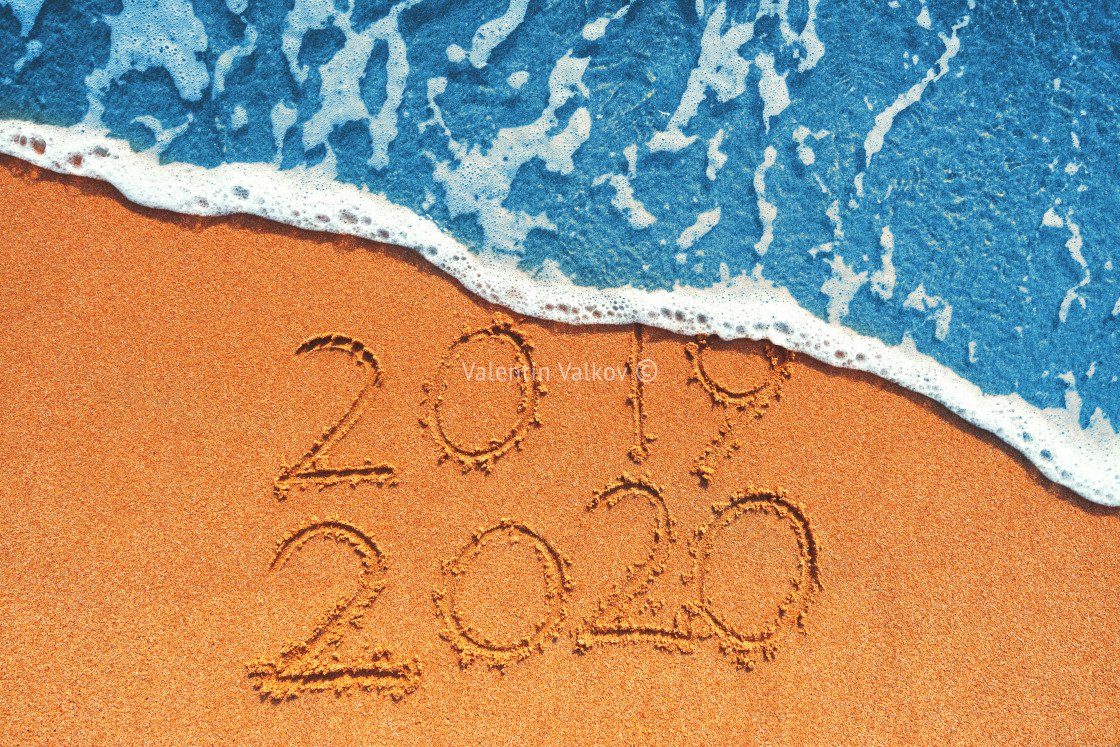 """Happy New Year 2020 concept, lettering on the beach. Sea sunrise"" stock image"