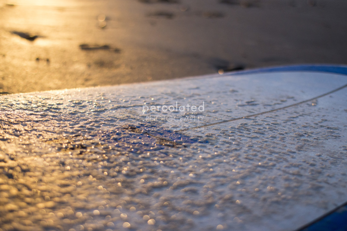 """Surfboard in the evening sun"" stock image"