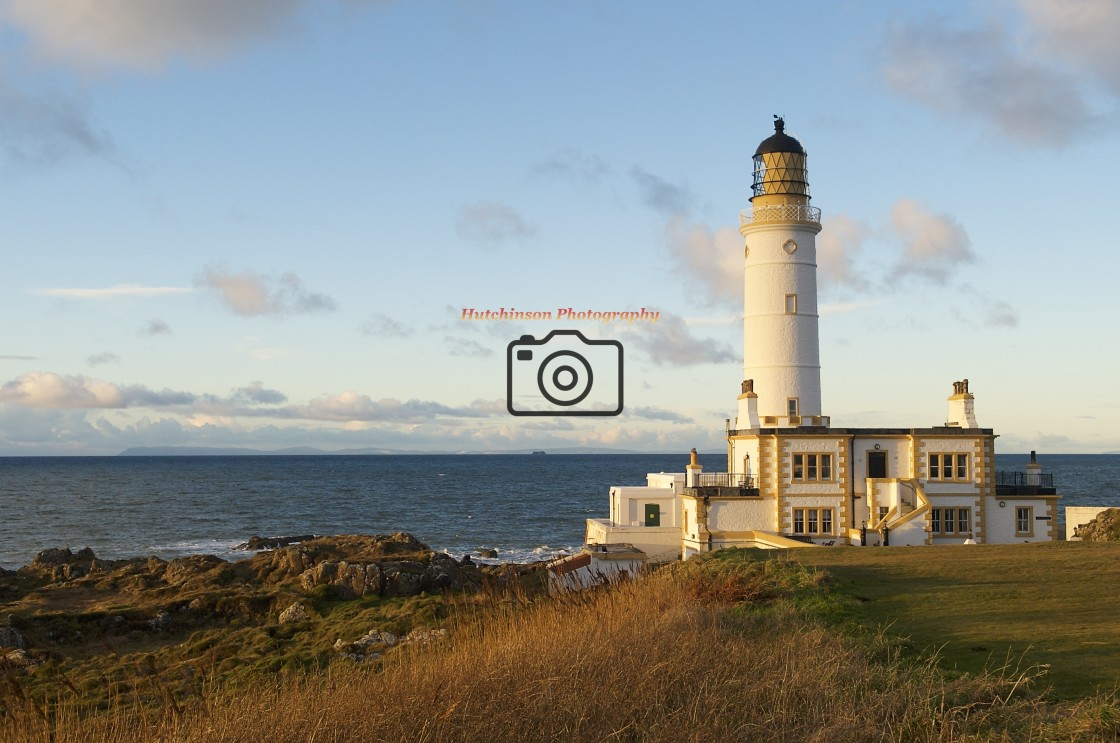 """""""Lighthouse at Sunset, Dumfries and Galloway"""" stock image"""