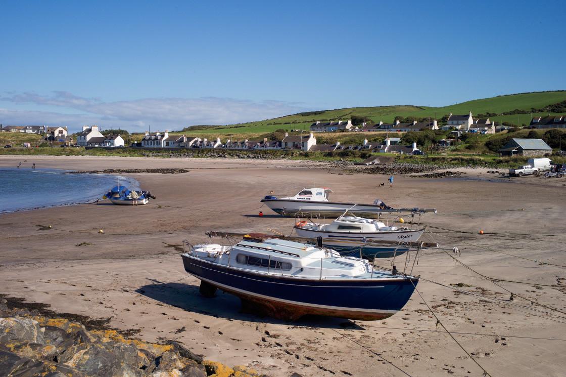 """""""Beach and Boats at Port Logan"""" stock image"""