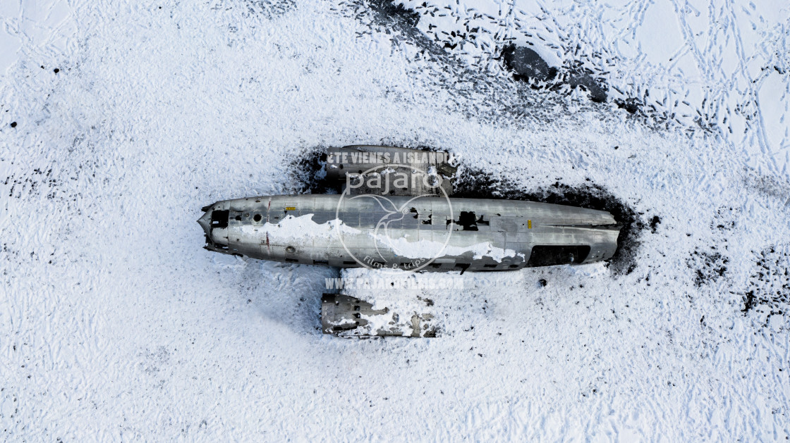 """A CRASHED PLANE IN THE SNOW"" stock image"