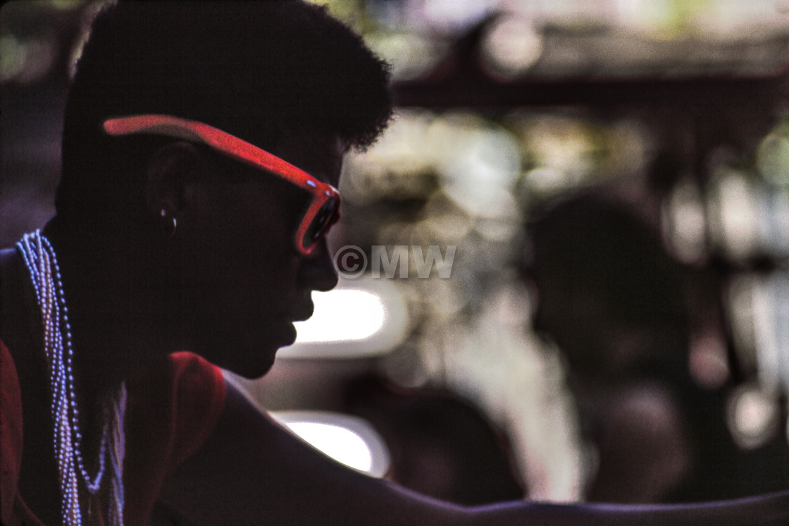 """""""Young black female silhouette with purple beads & red sunglasses"""" stock image"""