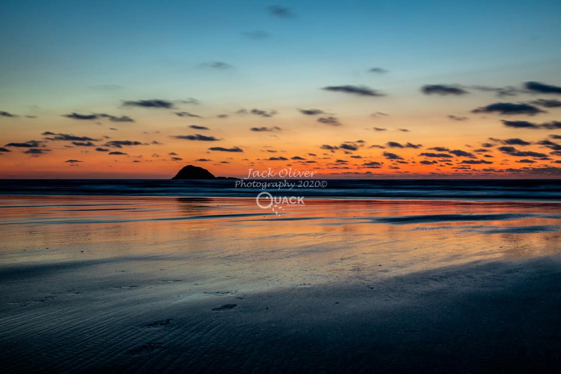 """Sunset Over Muriwai Beach"" stock image"