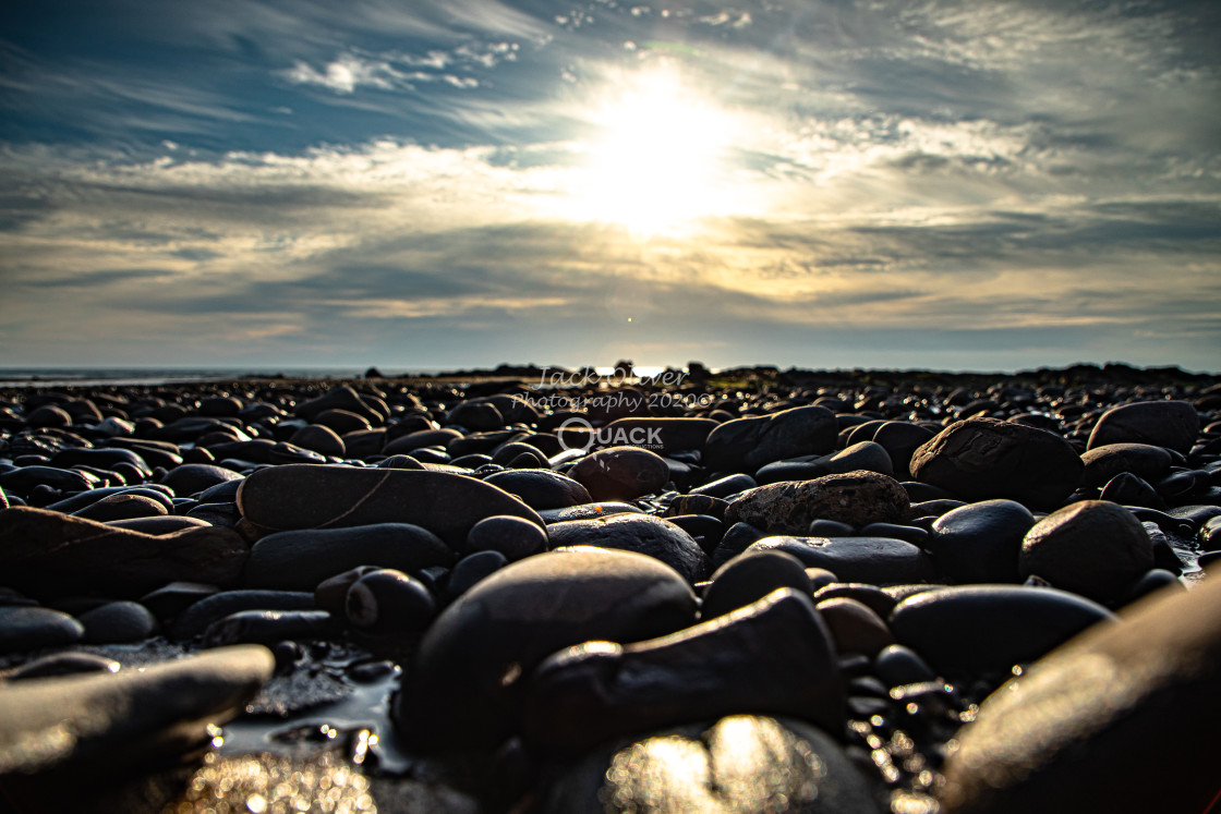 """Pebble Sunset"" stock image"