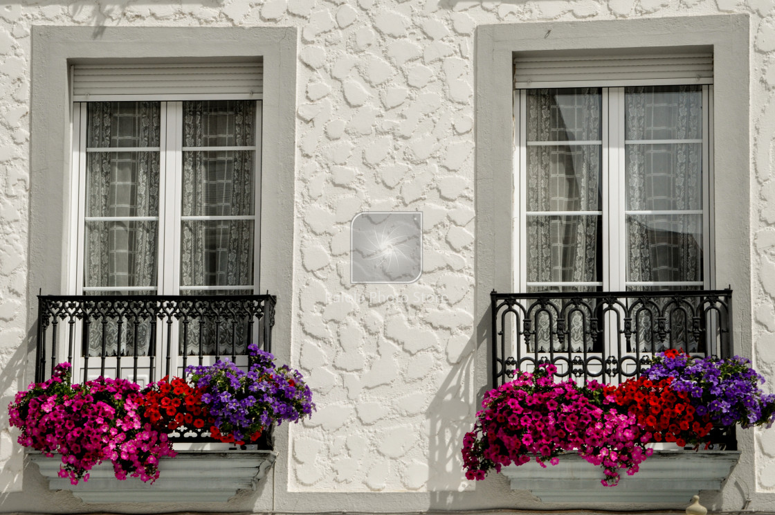 """A flowered balcony in Spain"" stock image"