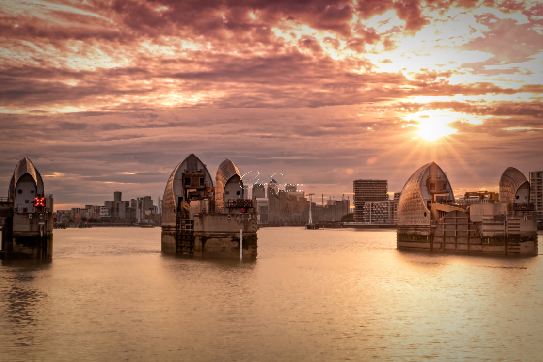 """""""Thames Barrier night shot with glorious sunset."""" stock image"""
