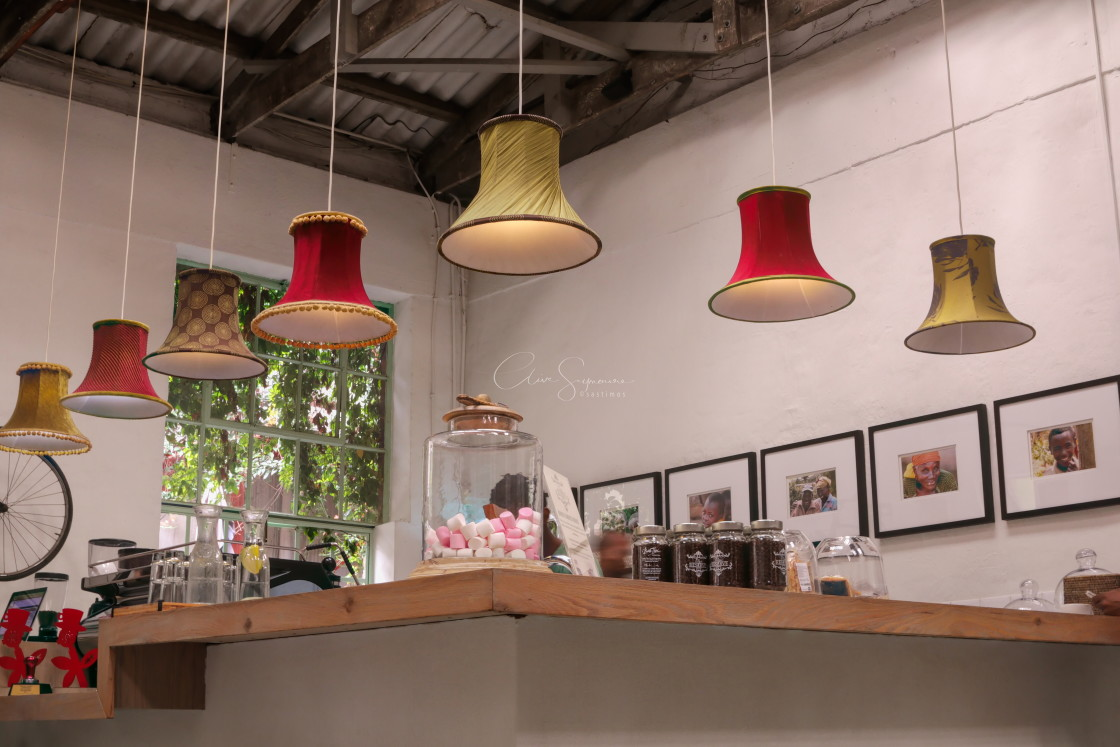 """""""Unusual lampshades used for cafe counter lighting"""" stock image"""