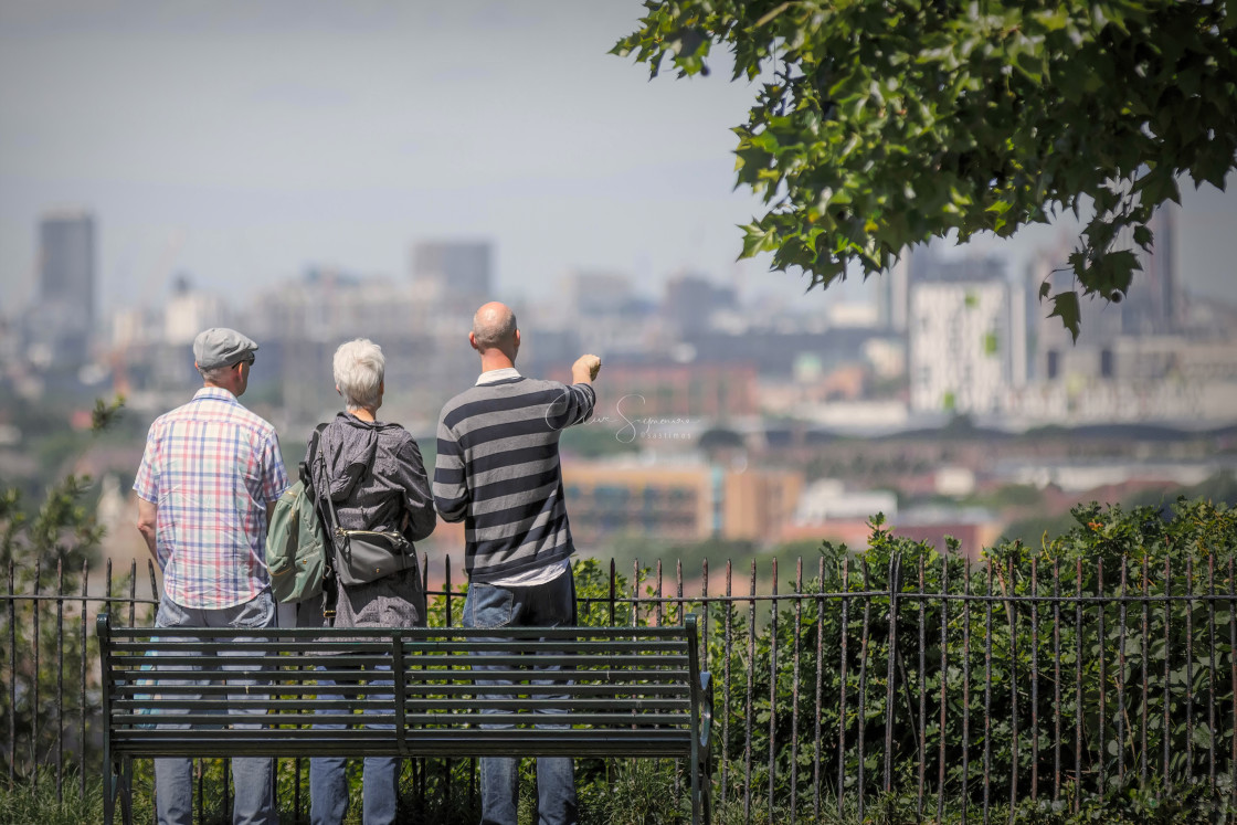 """Three tourists standing looking over towards London"" stock image"