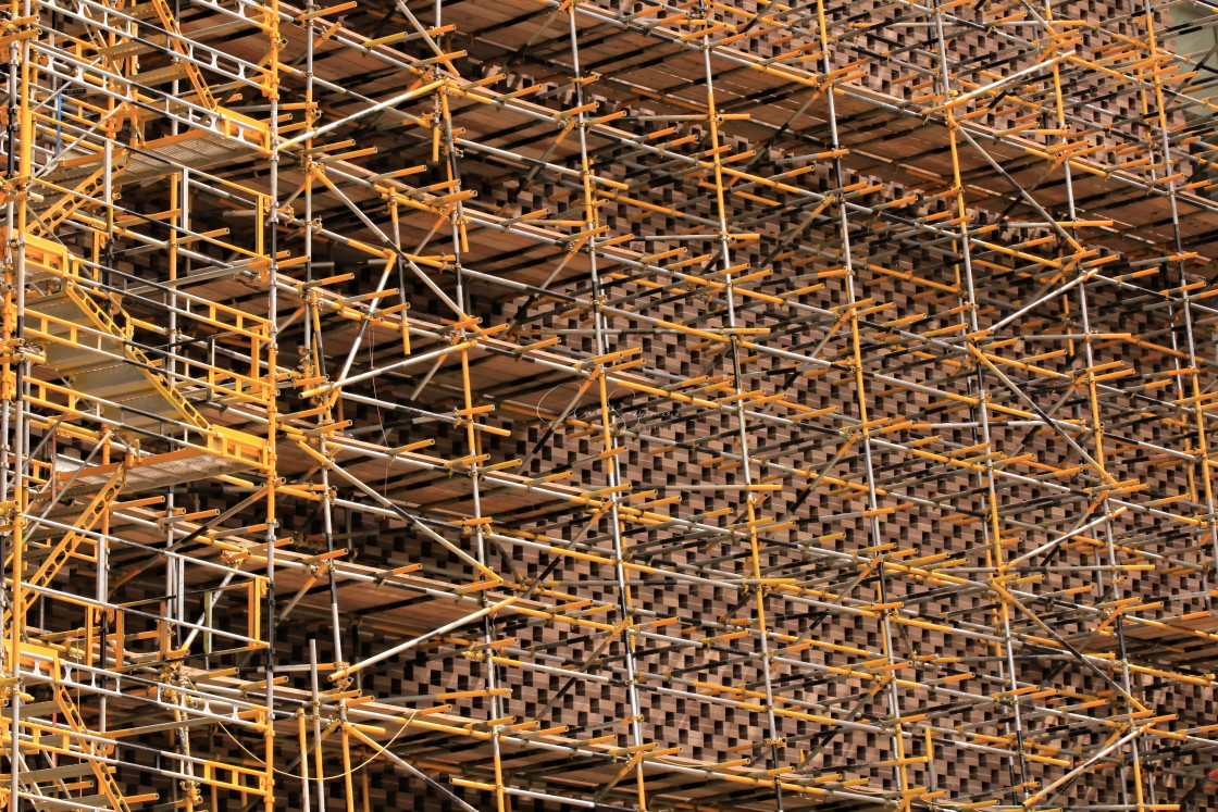 """""""Bright Yellow and silver scaffolding on the outside of a building"""" stock image"""