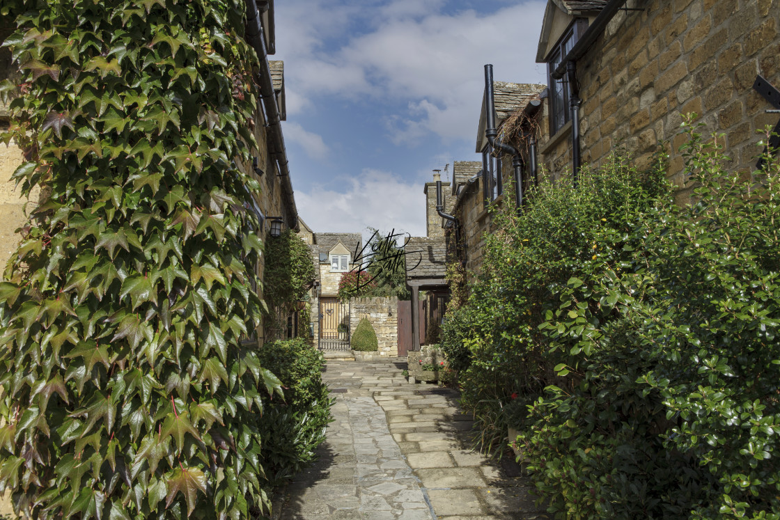 """Quaint street in the Cotswolds"" stock image"